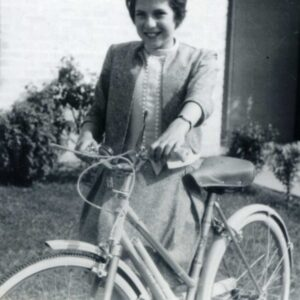 Me age 12 holding my new bike, with new haircut and new clothes, smiling.
