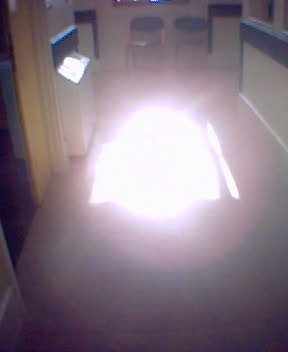 A phone camera pic of a puddle of sunlight on a psychiatric ward corridor floor.