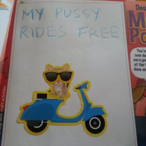 In an activity booklet there is a rectangular blank space. In it, written with coloured pencils, are the words: Pussy Rides Free. Below the text, made up of stickers, is a pussy cat in sunglasses riding a moped.
