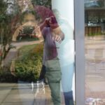 Portrait photo made by the group of several figures reflected in glass