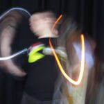 portrait photo of an individual blurred by a display of digital lighting effects