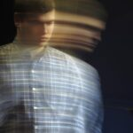 Blurred portrait photo of a young man
