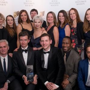 A photograph of the cast and crew of the BBC's See Hear programme receiving an award at an awards ceremony