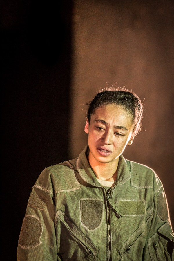 Charmaine Wombwell in Deafinitely Theatre's Grounded. She has a sombre expression on her face