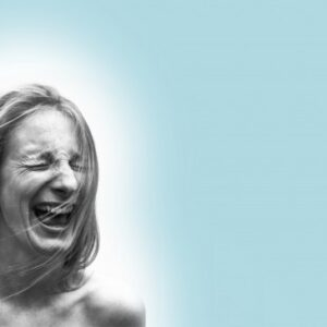 black and white image of a young woman with eyes closed and mouth wide open, set against a light blue background