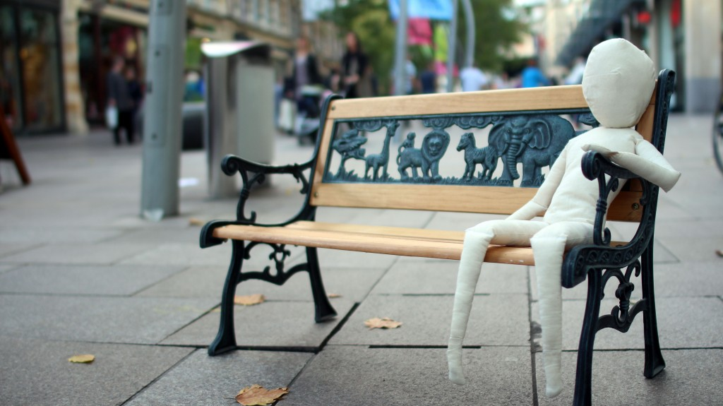 A promotional shot for Hijinx's production Meet Fred. A cloth puppet sits on a bench.