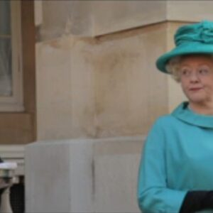 still from gary thomas film the dog and the palace of an actress dressed as the queen addressing an actor dressed as her servant