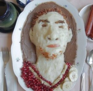 A still from the film with an image of a man the artist knows rendered as food on plate