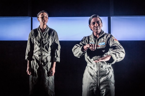 Nadia Nadarajah and Charmaine Wombwell as the Pilot in Deafinitely Theatre's Grounded. They both wear flight suits.