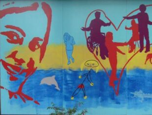 Colourful wall mural, beach background and womans face smiling