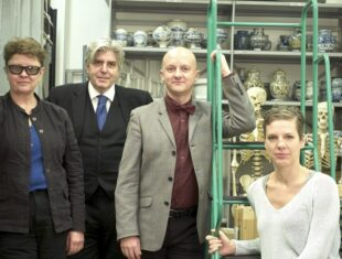 Photo of the four commissioned artists, pictured in a museum archive