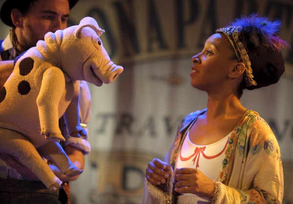 A photograph from Edmund the Learned Pig, featuring the titular puppet talking to another character.