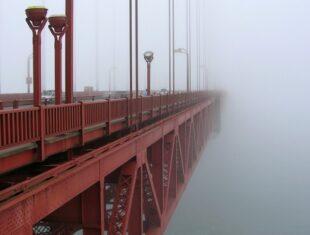The Golden Gate Bridge pictured in fog.