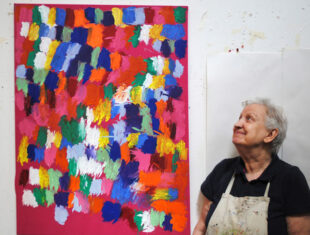 Connie Moth-Price with her colourful painting