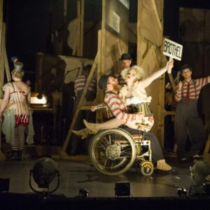 Jamie Beddard hams it up as Mack the Knife's henchman Mathias in the National Theatre's production of The Threepenny Opera