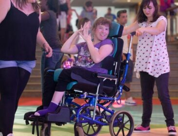 Three young people take part in a session, one of them is a wheelchair user