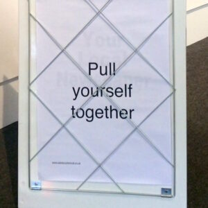 photo of a billboard with the message 'pull yourself together'