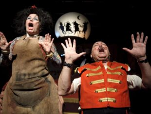 A scene from Edmund-the-Learned-Pig-Caroline-Parker-as-The-Missus-and-Garry-Robson-as-Barry-Bonaparte-Photo-by-Joel-Fildes