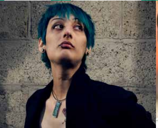 Photograph of artist Maki Yamazaki, she has blue hair
