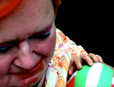 Image of Katherine Araniello holding a beach ball with a prosthetic hand.