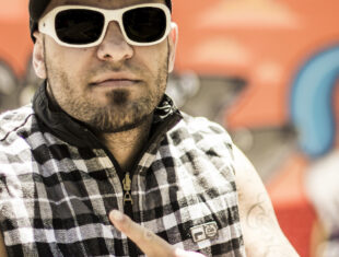 photo of Brazilian rapper Billy Saga wearing sun-glasses