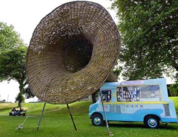 Sculpture by Oliver Macdonald which features and ice cream van with a woven speaker coming out of one of the windows