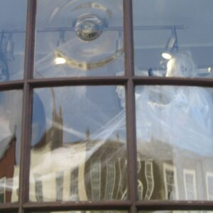 a hairdressers shop window in highgate dressed for halloween with witchess and ghosts