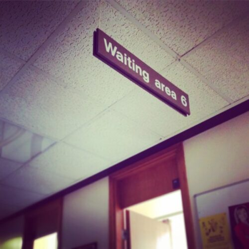 Image of a hospital waiting area sign.