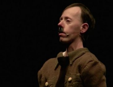 Screenshot of actor dressed as Adolph Hitler