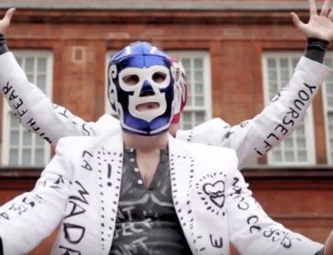 Shot of male dancer wearing a blue mask.
