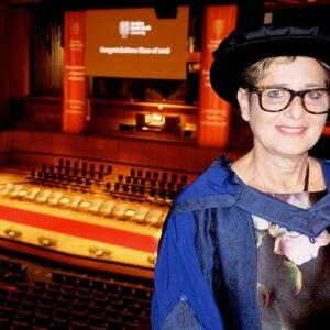 Photo of artist Rachel Gadsden dressed in ceremonial gown