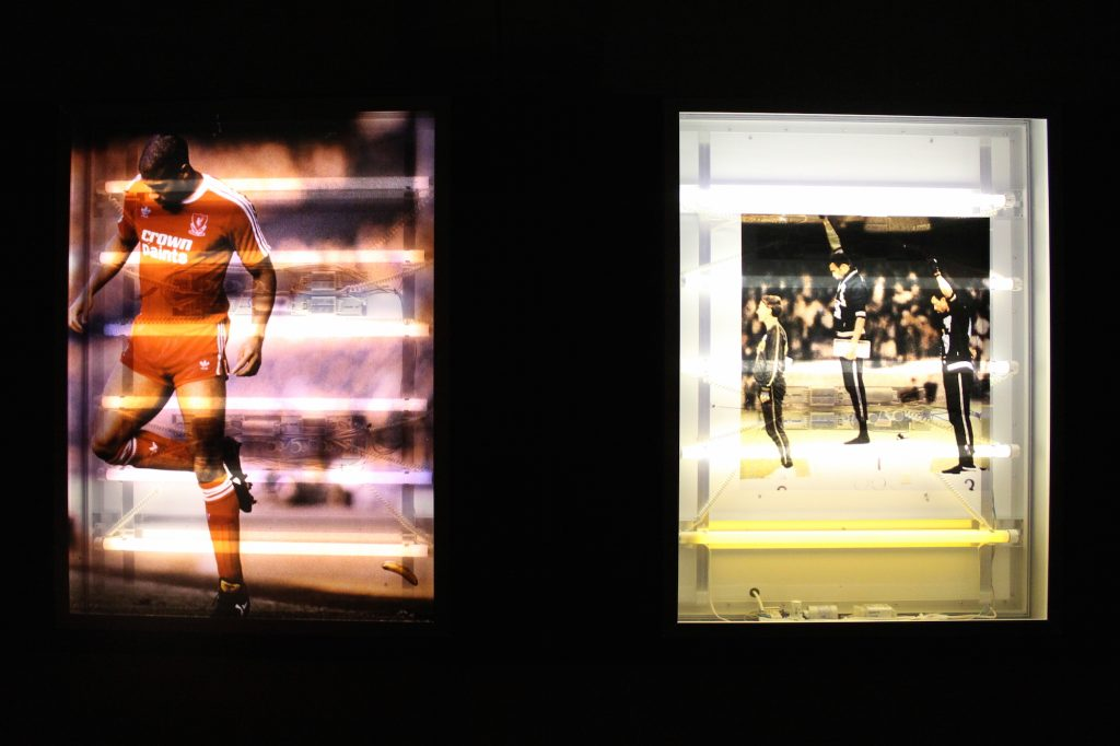 Images of footballer John Barnes and two black athletes at the Mexico Olympics surrounded by a dark surround