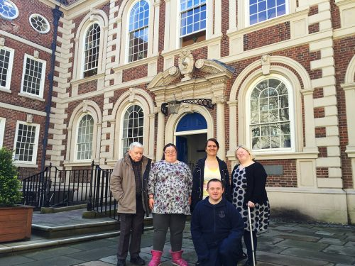 Photo of a group of artists standing outside the Bluecoat Arts Centre in Liverpool