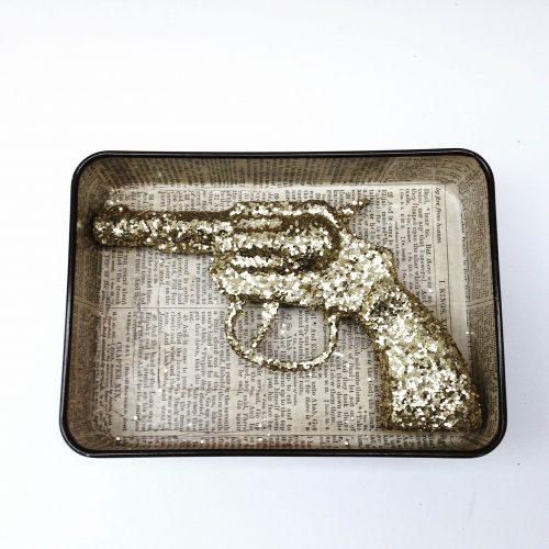 Jane McCormick assemblage: Golden Gun