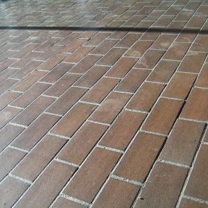 colour photograph of a tiled floor holding dust