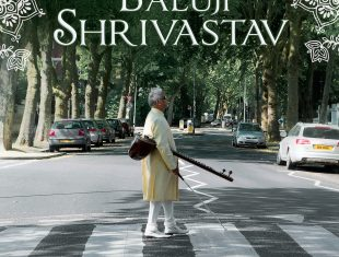 photo of sitar player Baluji Shrivastrav standing on a zebra crossing