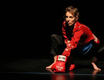 Dancer with boxing glove on