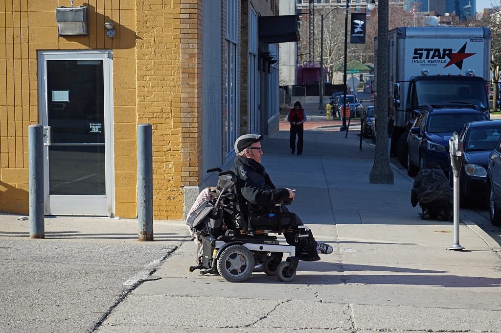 Photo of a wheelchair-user out on the street