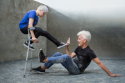Photo of two dancers with crutches