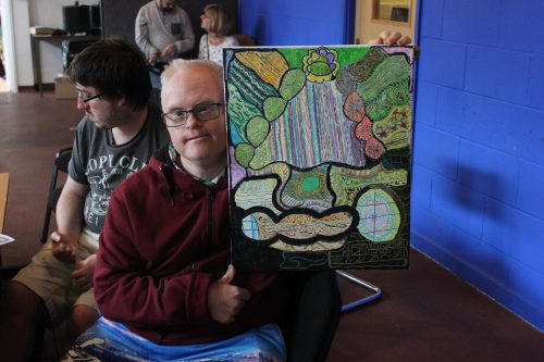 Richard Hunt shows a new canvas he has created