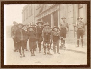 Archive sepia photo of a group of young disabled men in uniform