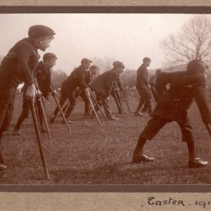 Archive sepia photo of a group of young disabled men with crutches