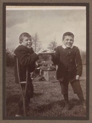 Archive sepia photo of a two young disabled boys with crutches