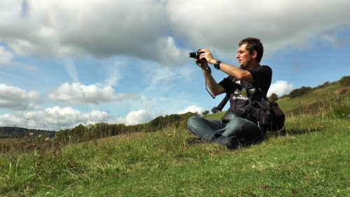 Mark Hemsworth of Shadowlight Artists based at Film Oxford taking photographs in Chiltern Hills near Turville