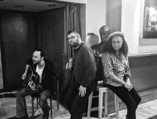 Black and white photo of actors Chris Campion and Steve George jamming with Extant CEO Maria Oshodi at BIT Fest in Zagreb