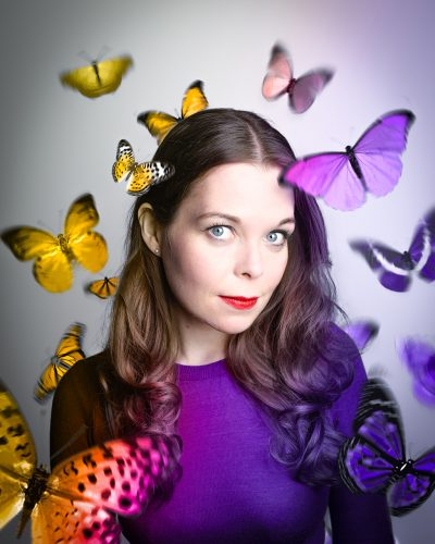 Juliette Burton surrounded by butterflies