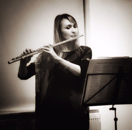Sepia photo of Ruth Montgomery playing the flute
