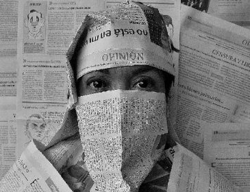 Woman with newspaper cover her face, like a burka