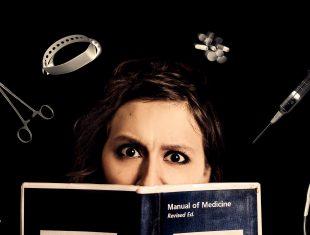 Helen Black, hiding behind a book