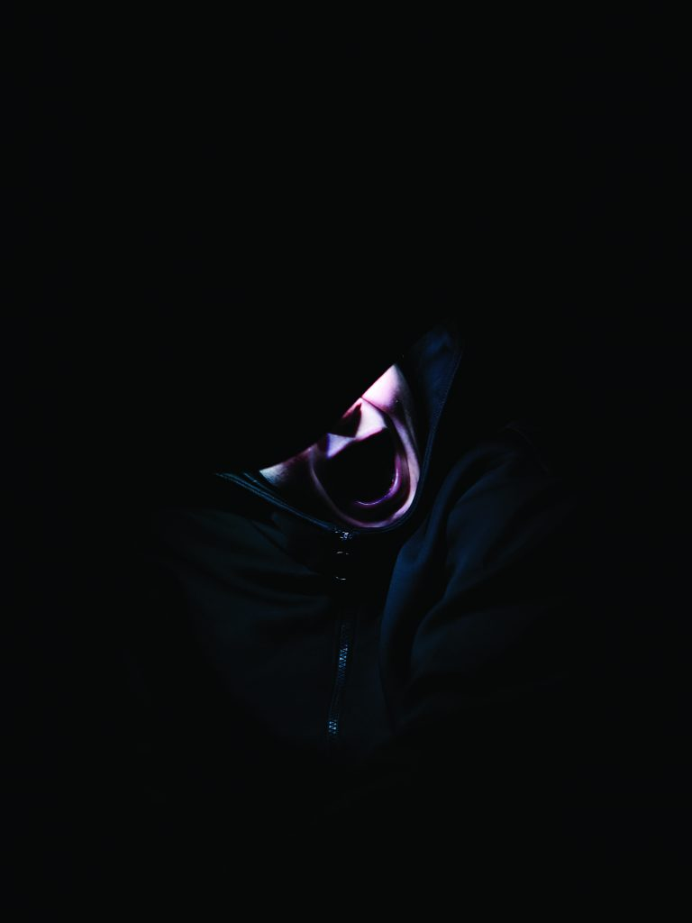 A face illuminated by the hood it's wearing